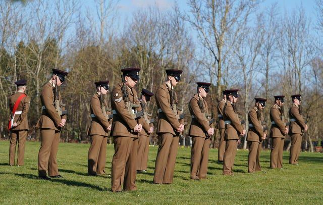 Members of the Armed Forces pay respects at the funeral