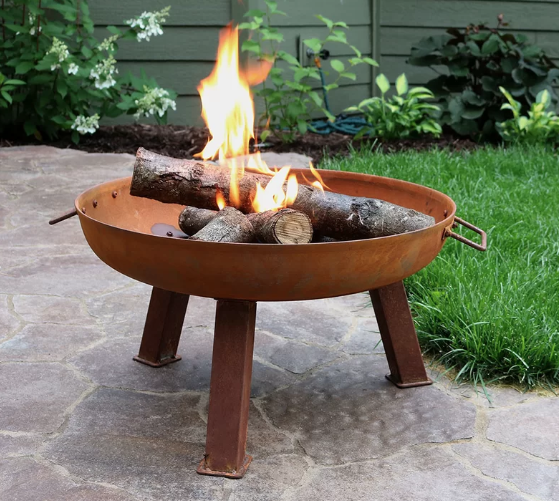 """This fire pit, made of heavy-duty cast iron, comes in <a href=""""https://www.architecturaldigest.com/story/how-to-remove-rust-from-metal-knives-tools-and-objects?mbid=synd_yahoo_rss"""" rel=""""nofollow noopener"""" target=""""_blank"""" data-ylk=""""slk:rust"""" class=""""link rapid-noclick-resp"""">rust</a> (pictured) or steel and is available in several sizes. $212, Serenity Health & Home Decor. <a href=""""https://serenityhealth.com/sunnydaze-rustic-cast-iron-fire-pit-bowl/"""" rel=""""nofollow noopener"""" target=""""_blank"""" data-ylk=""""slk:Get it now!"""" class=""""link rapid-noclick-resp"""">Get it now!</a>"""