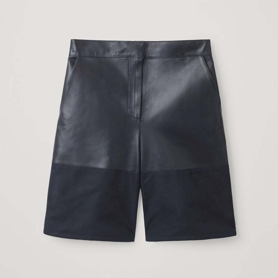 """$350, Cos. <a href=""""https://www.cosstores.com/en_usd/women/womenswear/shorts/product.leather-shorts-with-woven-panel-blue.0881402002.html"""" rel=""""nofollow noopener"""" target=""""_blank"""" data-ylk=""""slk:Get it now!"""" class=""""link rapid-noclick-resp"""">Get it now!</a>"""