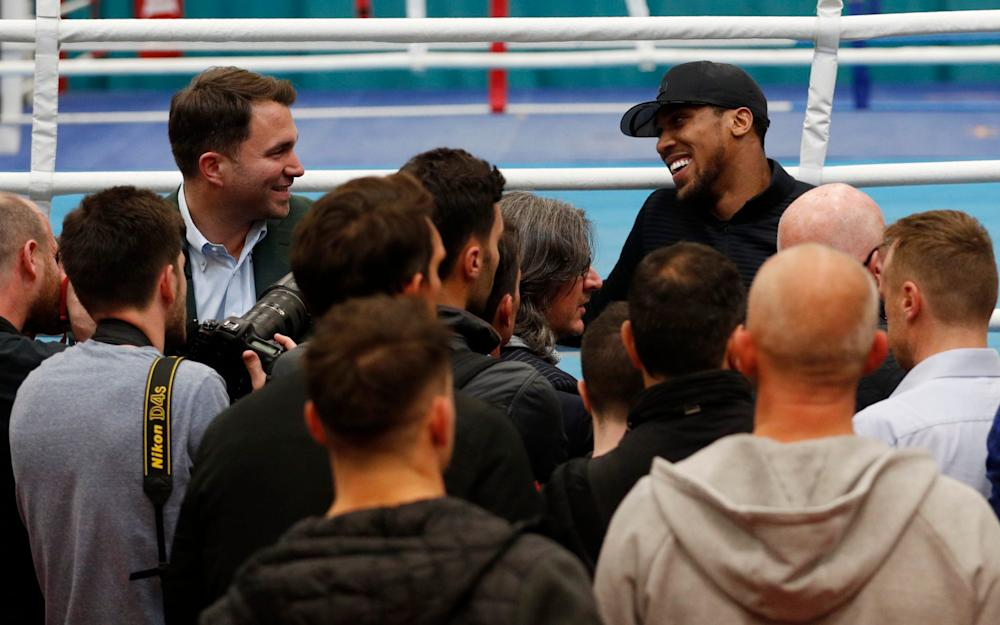 Anthony Joshua and promoter Eddie Hearn during a media session  - Credit: Reuters