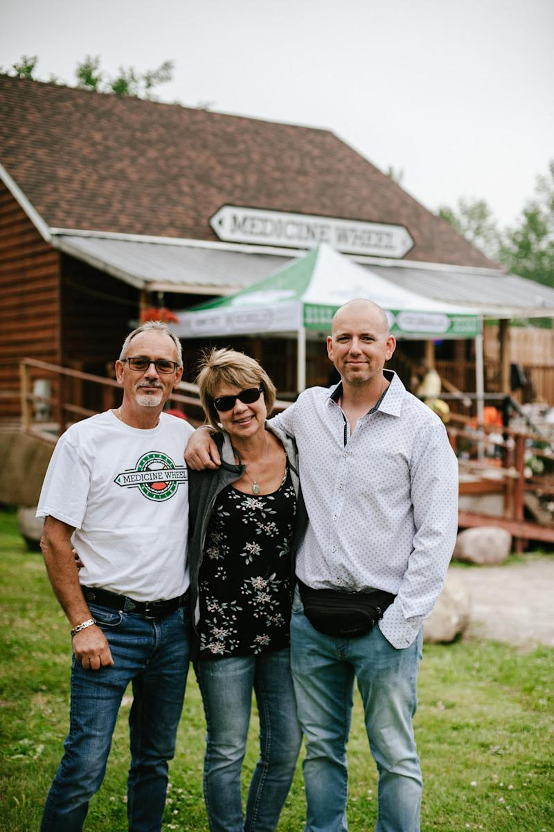Rob Stevenson and his parents, Glen and Charlene, stand in front of their Indigenous-owned and operated cannabis store on the Alderville First Nation. (Provided)