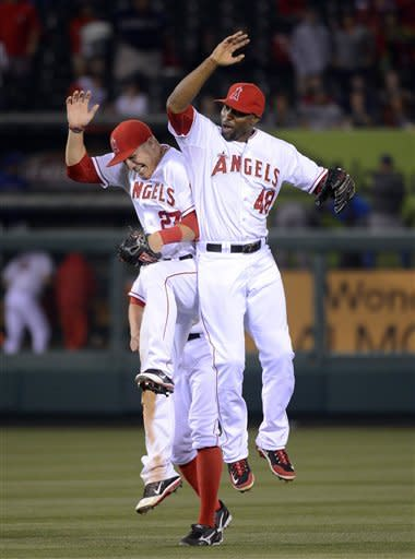 Los Angeles Angels center fielder Mike Trout, left, and right fielder Torii Hunter celebrates after they defeated the Texas Rangers 3-2 in their baseball game, Saturday, June 2, 2012, in Anaheim, Calif. (AP Photo/Mark J. Terrill)