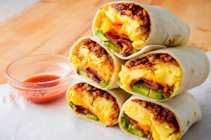 "<p>A breakfast burrito is easy to make and often a fan favorite. Serve with a side of salsa or some hot sauce so your mom can kick it up a notch. </p><p><strong><em>Get the recipe at <a href=""https://www.delish.com/cooking/recipe-ideas/a24569400/breakfast-burrito-recipe/"" rel=""nofollow noopener"" target=""_blank"" data-ylk=""slk:Delish"" class=""link rapid-noclick-resp"">Delish</a>. </em></strong></p>"