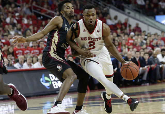 "Florida State's Braian Angola guards North Carolina State's <a class=""link rapid-noclick-resp"" href=""/ncaab/players/126454/"" data-ylk=""slk:Torin Dorn"">Torin Dorn</a> (2) during the first half of an NCAA college basketball game in Raleigh, N.C., Sunday, Feb. 25, 2018. (AP Photo/Gerry Broome)"