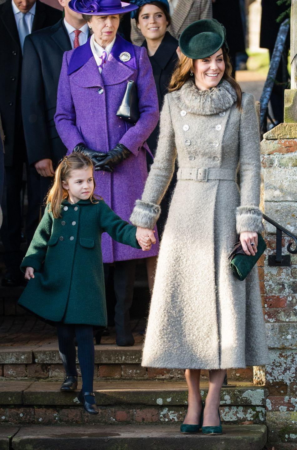<p>To attend Christmas Day services at Sandringham, Kate paired a chic gray coat with dark green accessories—the latter of which went well with the coat her daughter, Princess Charlotte, was wearing.</p>