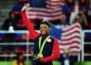 <p>Gold medalist Simone Biles of the United States celebrates on the podium at the medal ceremony for the Women's Individual All Around on Day 6 of the 2016 Rio Olympics at Rio Olympic Arena on August 11, 2016 in Rio de Janeiro, Brazil. (Photo by Harry How/Getty Images) </p>