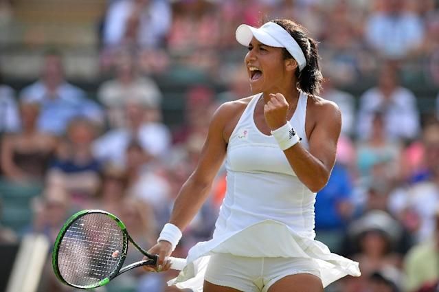 Britain's Heather Watson reacts against Slovakia's Daniela Hantuchova during their women's singles second round match on day three of the 2015 Wimbledon Championships at The All England Tennis Club in Wimbledon, southwest London, on July 1, 2015 (AFP Photo/Glyn Kirk)