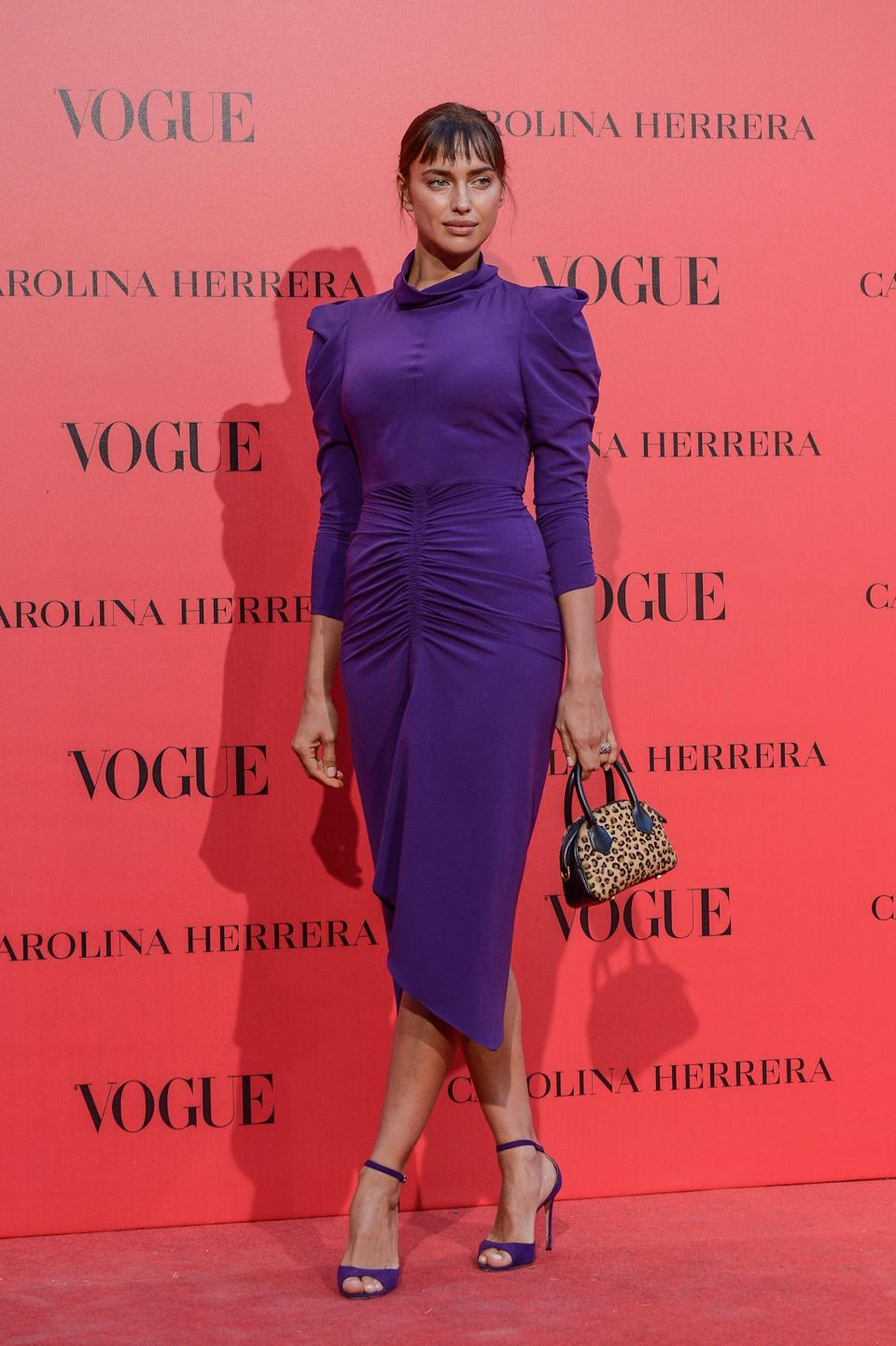 <p>Irina Shayk donned this season's most popular hue in a midi dress and co-ordinating shoes. We don't know about you but we need her clashing handbag, asap. <em>[Photo: Getty]</em> </p>