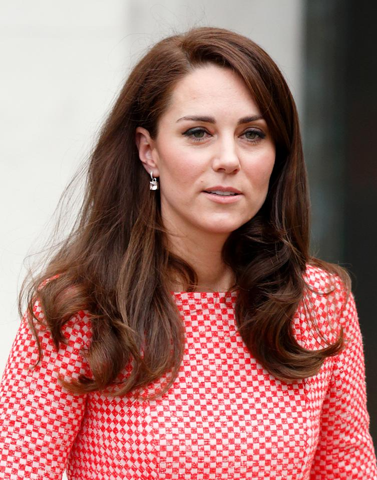 <p>The Duchess's ravishing locks looked brighter than usual, but her classic blowout remained in tact. (Photo: Max Mumby/Indigo/Getty Images) </p>