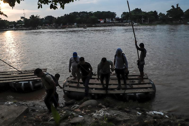 Central American migrants use a makeshift raft to illegally cross the Suchiate river from Tecun Uman, in Guatemala, to Ciudad Hidalgo, Mexico -- the US is trying to stem the flow of migrants towards the US border