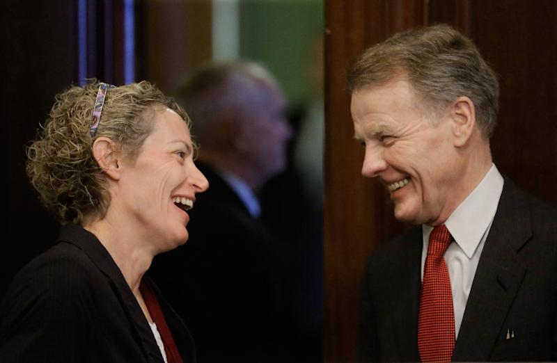 Illinois Speaker of the House Michael Madigan, D-Chicago, right, and Illinois Rep. Elaine Nekritz, D-Buffalo Grove, talk during a Pension Committee hearing at the Illinois State Capitol Tuesday, Dec. 3, 2013, in Springfield, Ill. (AP Photo/Seth Perlman)