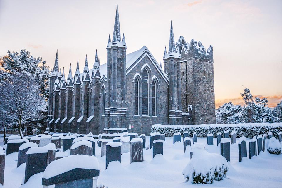"""Ireland's capital is one of our favorite places to <a href=""""https://www.cntraveler.com/story/what-to-do-in-dublin-this-month?mbid=synd_yahoo_rss"""" rel=""""nofollow noopener"""" target=""""_blank"""" data-ylk=""""slk:visit in winter"""" class=""""link rapid-noclick-resp"""">visit in winter</a>—and not just because of all those cozy little pubs. For the past nine years, the city has hosted the magical Smashing Times City of Dublin Parade, a festival that honors the Winter Solstice (December 21) with céilí dancing, traditional storytelling, and a fire ceremony. <a href=""""https://www.cntraveler.com/destinations/dublin?mbid=synd_yahoo_rss"""" rel=""""nofollow noopener"""" target=""""_blank"""" data-ylk=""""slk:Dublin"""" class=""""link rapid-noclick-resp"""">Dublin</a> also gets lights up even more around New Year's Eve, with events like light festival Luminosity, and the world's largest Celtic drum session set around town. Of course, there is also beauty in the season itself: James Joyce's short story """"The Dead,"""" even pays tribute to the city's snow-covered graveyards."""