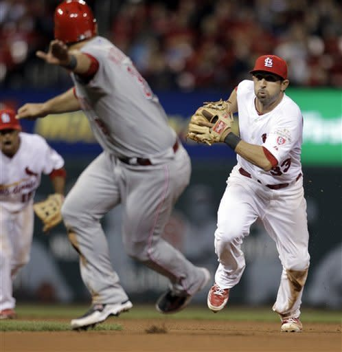 St. Louis Cardinals second baseman Daniel Descalso, right, prepares to tag out Cincinnati Reds' Devin Mesoraco during the 10th inning of a baseball game Tuesday, April 17, 2012, in St. Louis. (AP Photo/Jeff Roberson)