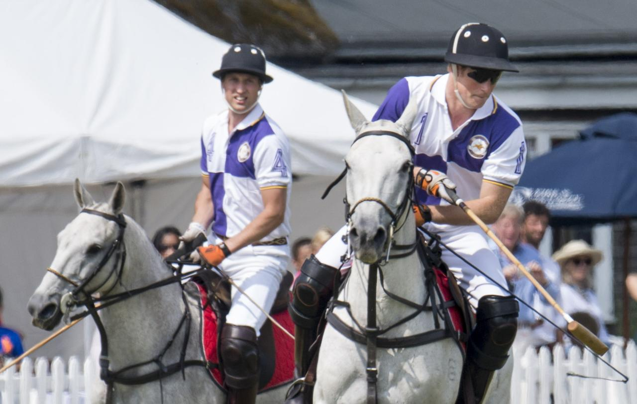 CIRENCESTER, ENGLAND - JULY 14: Prince William, Duke of Cambridge and Prince Harry take part in The Jerudong Trophy at Cirencester Park Polo Club on July 14, 2013 in Cirencester, England. (Photo by Mark Cuthbert/UK Press via Getty Images)
