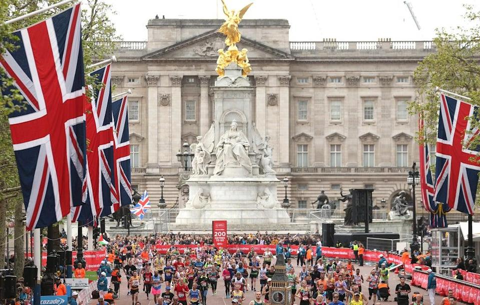 Runners near the finish line during the 2019 Virgin Money London Marathon (PA) (PA Archive)