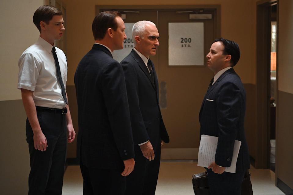 """Glynn Lunney (Jackson Pace), left, Chris Craft (Eric Ladin), Bob Gilruth (Patrick Fischler) and John """"Shorty"""" Powers (Danny Strong) are members of the NASA braintrust in Disney+'s 'The Right Stuff.'"""