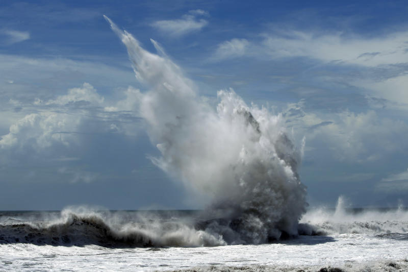 Strong waves batter breakwaters from approaching Typhoon Tembin in the coastal village of Ilan, Taiwan, Thursday, Aug. 23, 2012. More than 1,000 residents were evacuated from mountainous areas of Taiwan as the typhoon approaches the island, threatening to dump rains that could unleash deadly landslides. (AP Photo/Wally Santana)