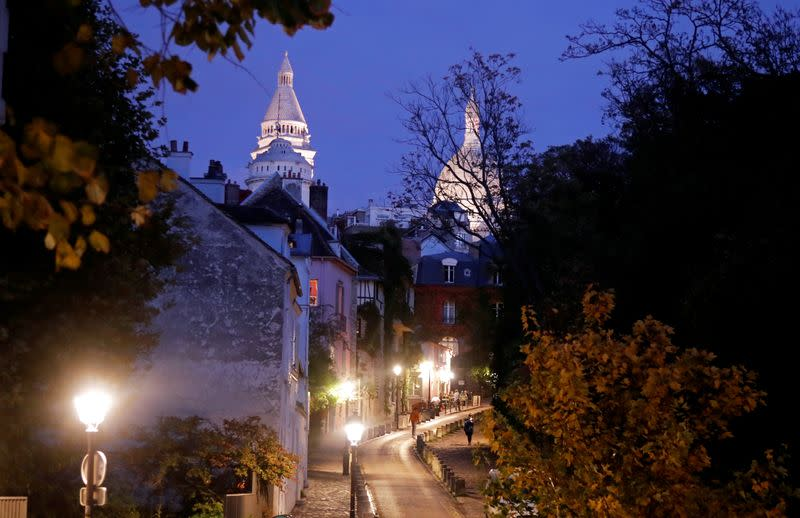 FILE PHOTO: A street is seen in Montmartre few minutes before the nightly curfew due to restrictions against the spread of the coronavirus disease (COVID-19) in Paris
