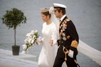 "<p>Dior's Marc Bohan designed Silvia's minimalist, floor-length gown for Sweden's first televised royal wedding. The bride accessorized notably, to say the least, wearing the Cameo Tiara that had been gifted by French Emperor Napoleon to his then-wife Josephine in the early 19th century.</p><p>Fellow history nerds: learning <a href=""http://www.thepracticalgemologist.com/jewelry-history-1/2015/8/4/the-swedish-cameo-tiara"" rel=""nofollow noopener"" target=""_blank"" data-ylk=""slk:how exactly"" class=""link rapid-noclick-resp"">how exactly</a> this crown fell into the hands of the Swedish monarchy makes for an actually pretty fun time. </p>"