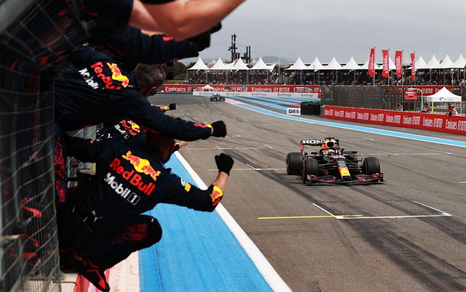 Red Bull Racing team members celebrate on the pitwall as Max Verstappen of the Netherlands driving the (33) Red Bull Racing RB16B Honda crosses the finish line to win during the F1 Grand Prix of France at Circuit Paul Ricard on June 20, 2021 in Le Castellet, France - Mark Thompson/Getty Images