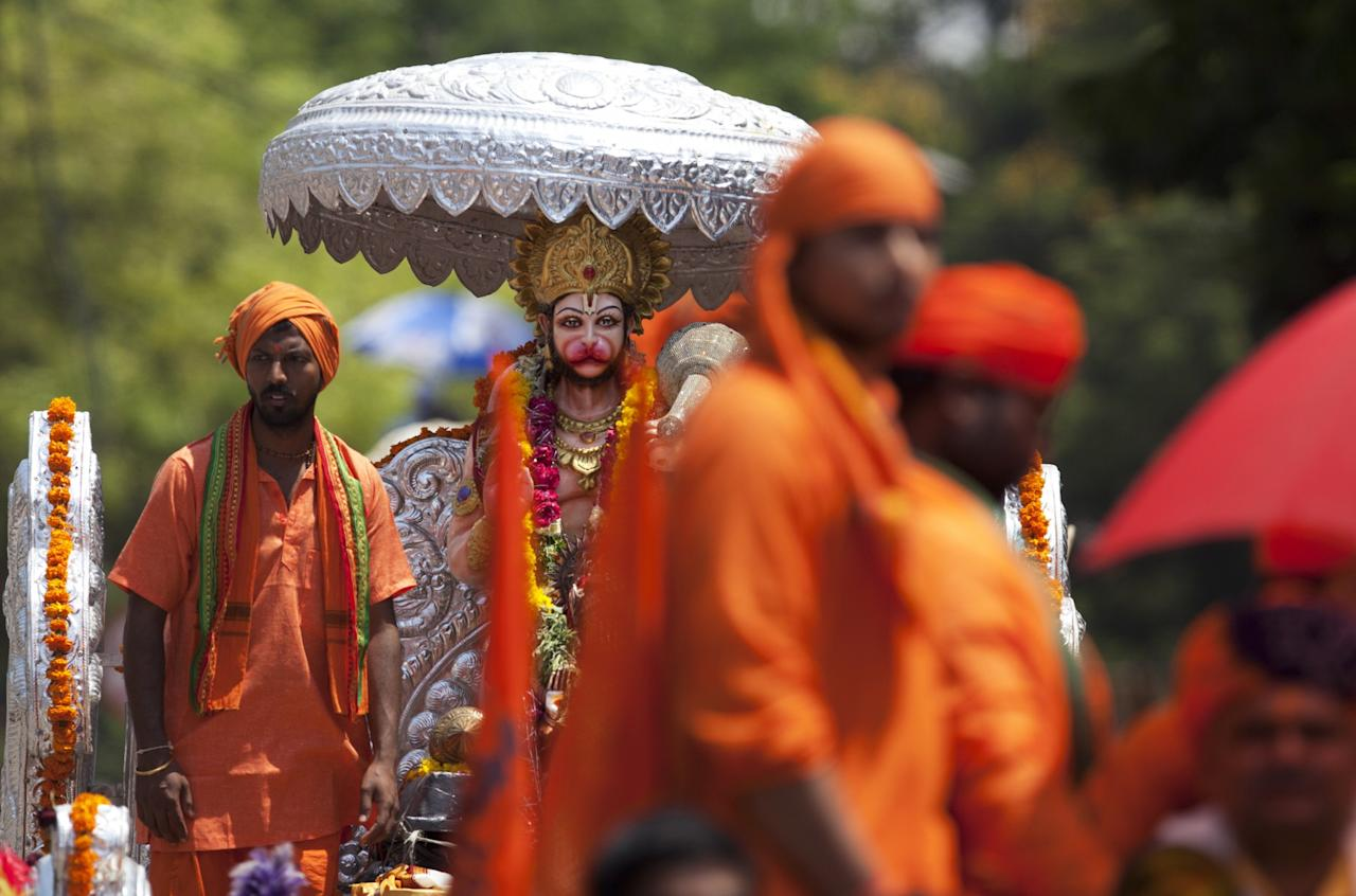 <p>Hindus participate in a religious procession to mark Hanuman Jayanti, a day that celebrates the birth monkey-god Hanuman, in Hyderabad, India, Tuesday, April 11, 2017. Hanuman is one of the most popular gods in the crowded pantheon of Hindu deities, and devout Hindus ascribe great strength and valor to him. (AP Photo/Mahesh Kumar A.) </p>