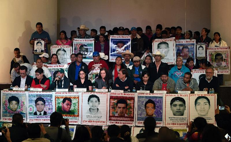 Relatives of the 43 missing students of Ayotzinapa and members of the Argentine Team of Forensic Anthropology give a press conference in Mexico City on February 9, 2016 about the human remains found in the Cocula rubbish dump