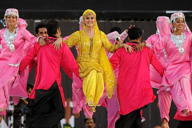 Bollywood actress Preity Zinta (C) performs during a ceremony before the IPL Twenty20 cricket match between Pune Warriors India and Kings XI Punjab at The Subrata Roy Sahara Stadium in Pune on April 8, 2012. AFP PHOTO/Punit PARANJPE (Photo credit should read PUNIT PARANJPE/AFP/Getty Images)