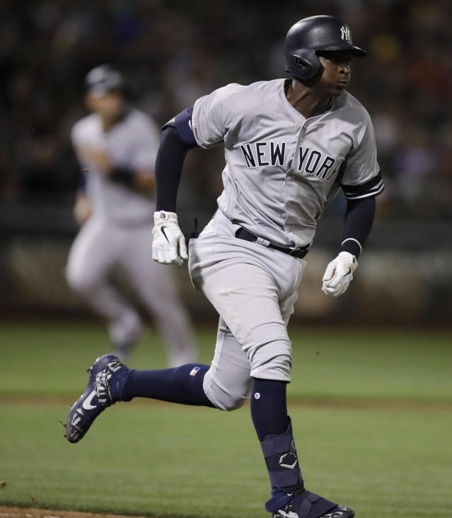 New York Yankees' Didi Gregorius runs after hitting an RBI double against the Oakland Athletics during the seventh inning of a baseball game Wednesday, Aug. 21, 2019, in Oakland, Calif. (AP Photo/Ben Margot)