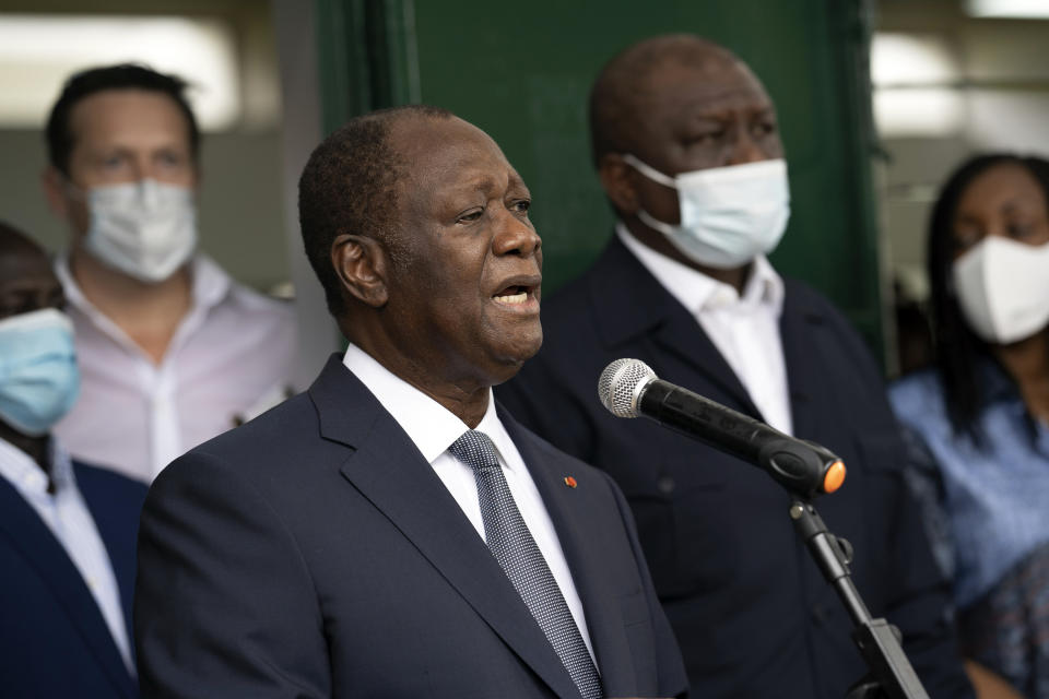 Ivory Coast President Alassane Ouattara speaks to journalists after voting at a polling station during presidential elections in Abidjan, Ivory Coast, Saturday, Oct. 31, 2020. Tens of thousands of security forces deployed across Ivory Coast on Saturday as the leading opposition parties boycotted the election, calling President Ouattara's bid for a third term illegal. (AP Photo/Leo Correa)