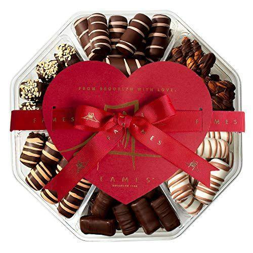 "<p><strong>Fames Chocolates</strong></p><p>amazon.com</p><p><strong>$39.99</strong></p><p><a href=""https://www.amazon.com/dp/B07L29ZB3S?tag=syn-yahoo-20&ascsubtag=%5Bartid%7C10050.g.5116%5Bsrc%7Cyahoo-us"" rel=""nofollow noopener"" target=""_blank"" data-ylk=""slk:Shop Now"" class=""link rapid-noclick-resp"">Shop Now</a></p><p>Satisfy Mom's sweet tooth with a box of mixed chocolates, (Maybe you'll even convince her to share!) </p>"