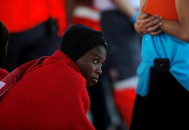 A migrant woman, part of a group intercepted aboard a dinghy off the coast in the Mediterranean Sea, rests after arriving on a rescue boat at the port of Malaga, Spain June 22, 2018. REUTERS/Jon Nazca TPX IMAGES OF THE DAY