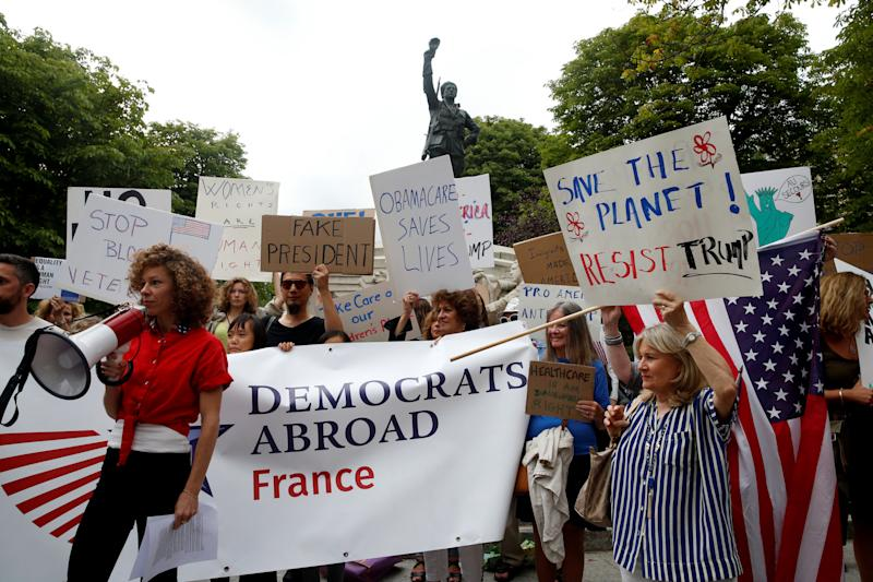 People gather to protest the visit of U.S. President Donald Trump in Paris on July 13, 2017. (Pascal Rossignol/Reuters)