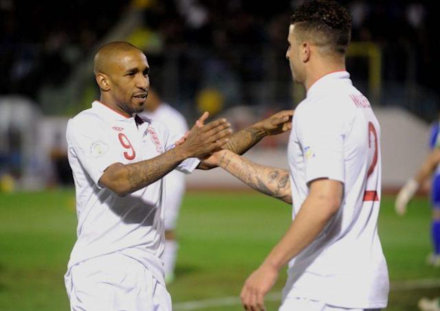 England's Jermain Defoe celebrates scoring their eighth goal with Kyle Walker (right) during the 2014 World Cup Qualifier at Serravalle Stadium, Serravalle, San Marino.
