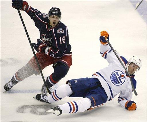 Columbus Blue Jackets' Derick Brassard (16) trips up Edmonton Oilers' Eric Belanger (20) in the third period of their NHL hockey game, Tuesday, March, 5, 2013, in Columbus, Ohio. (AP Photo/Mike Munden)