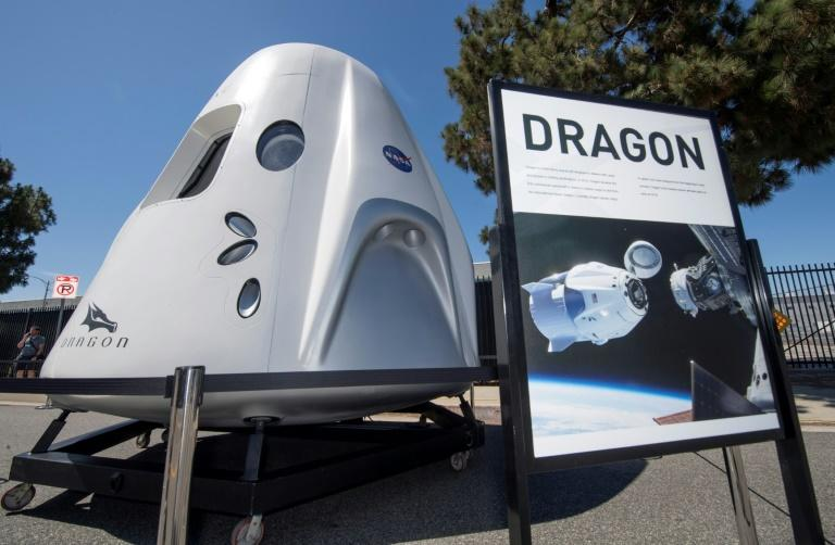 Tourists are to be carried on SpaceX's Crew Dragon capsule, which was developed to transport NASA astronauts and is due to make its first crewed flight in the coming months (AFP Photo/Mark RALSTON)