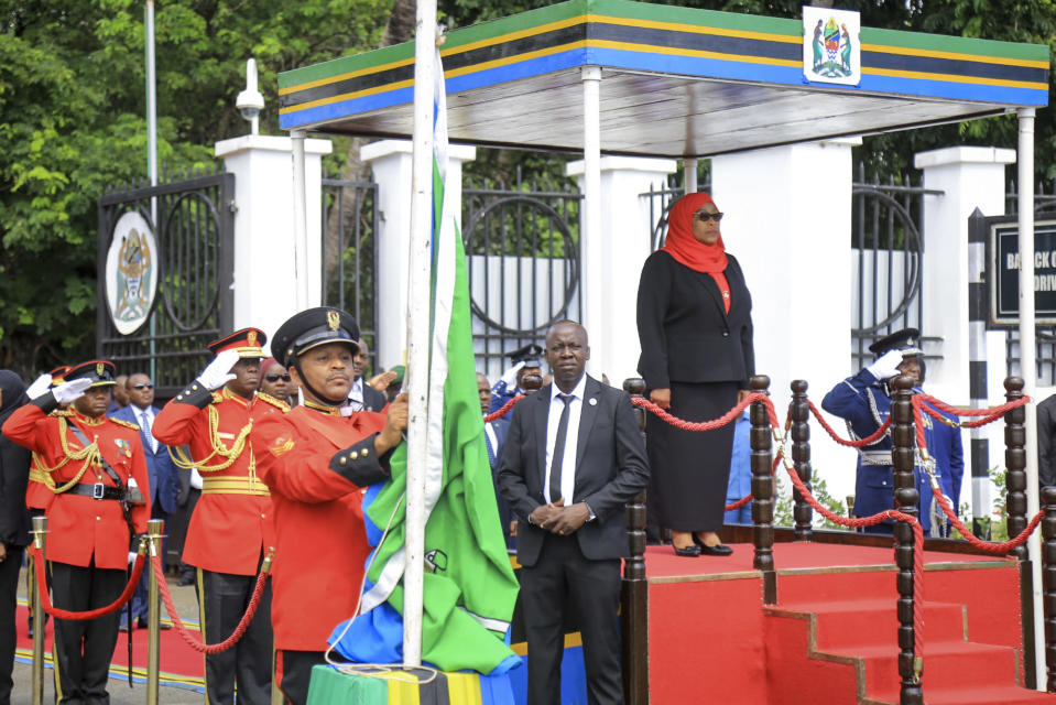 Tanzania's new president Samia Suluhu Hassan, right, is sworn in at a ceremony at State House in Dar es Salaam, Tanzania Friday, March 19, 2021. Samia Suluhu Hassan made history Friday when she was sworn in as Tanzania's first female president, following the death of her predecessor John Magufuli. (AP Photo)