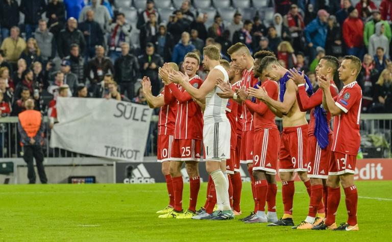 Bayern Munich's players celebrate winning their UEFA Champions League Group B match against Anderlecht, in Munich, on September 12, 2017