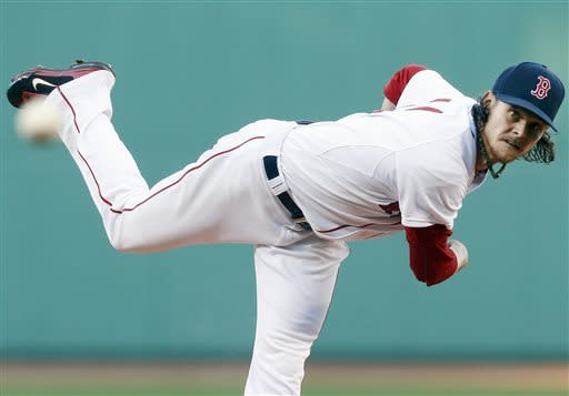 Boston Red Sox's Clay Buchholz pitches in the first inning of a baseball game against the Houston Astros in Boston, Thursday, April 25, 2013. (AP Photo/Michael Dwyer)