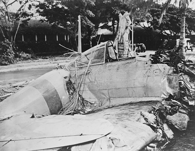 <p>A Japanese Type 00 (Zero) fighter with markings from the carrier Akagi is seen after it crashed during the attack at Fort Kamehameha, near Pearl Harbor, on Dec. 7, 1941. (U.S. Navy/National Archives/Handout via Reuters) </p>