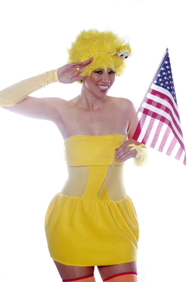 This undated image released by Scott Spellman shows Shannon Ziegler wearing a yellow dress, stockings and a fluffy hat that has google eyes. Halloweencostumes.com sold out of several takes on Big Bird almost overnight after Romney's remark during the first presidential debate Oct. 3. Disguise Inc., Sesame Workshop's official costume maker, said interest is up among the thousands of retailers it services. The sellers of unlicensed Big Bird, especially sexed-up versions, beware.  (AP Photo/Scott Spellman)