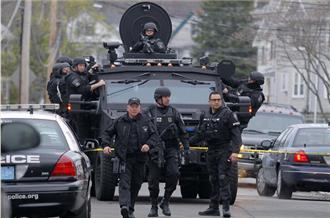 Boston on lockdown as police hunt suspect