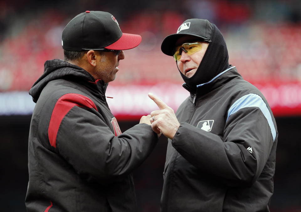 Arizona Diamondbacks manager Torey Lovullo, left, argues with umpire Mike Winters after he was ejected during the second inning of a baseball game against the St. Louis Cardinals, Sunday, April 8, 2018, in St. Louis. (AP Photo/Jeff Roberson)