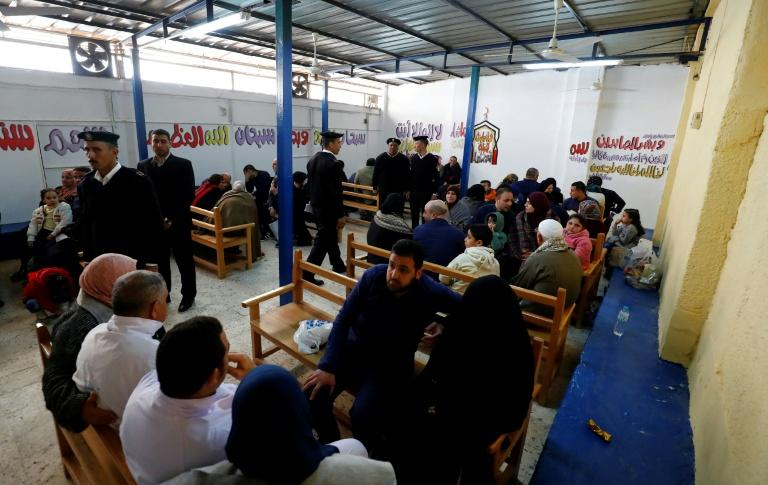 Prisoners meet with relatives during visiting hours at Cairo's Tora prison