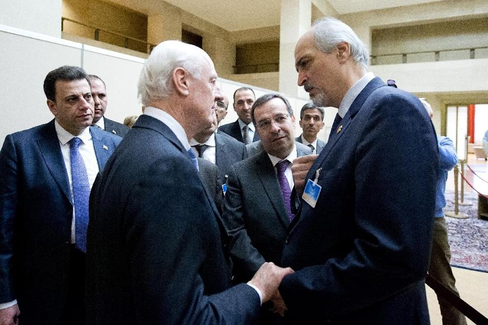 Syrian ambassador to UN and head of the government delegation Bashar al-Jaafari (right) is greeted by UN envoy for Syria Staffan de Mistura upon his arrival at the opening of Syrian peace talks (AFP Photo/)