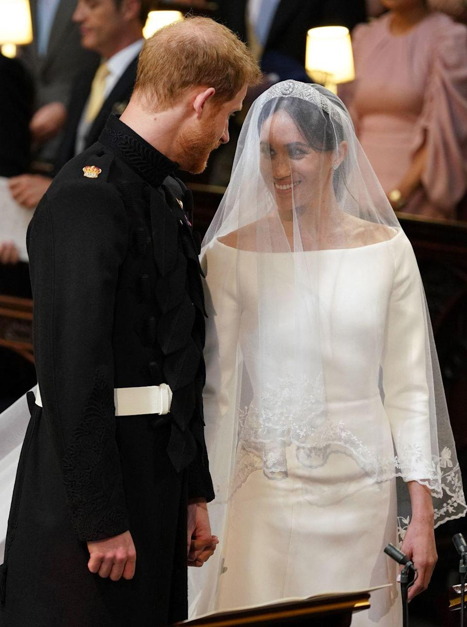 <p>Dressed in Givenchy, Meghan Markle looked a timeless beauty as she gazed into her husband Prince Harry's eyes as they said 'I do' at the royal wedding, May 2018</p>