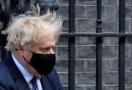 FILE PHOTO: Britain's PM Johnson outside Downing Street in London