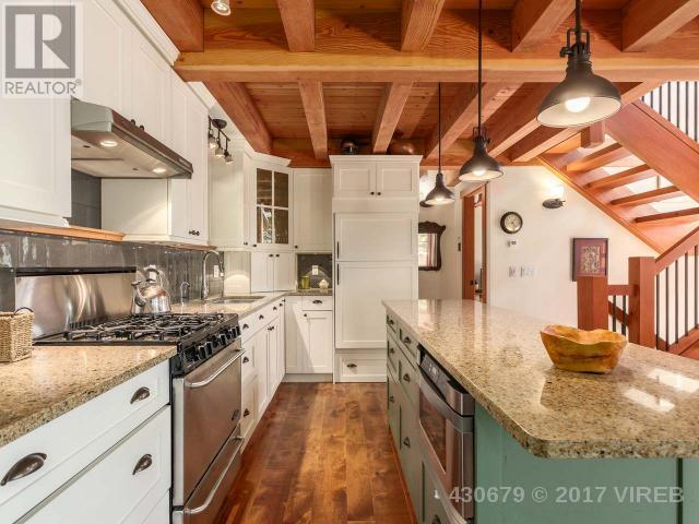 "<p><a rel=""nofollow"">3905 #407-3676 Horne Lake Caves Rd., Qualicum Beach, B.C.</a><br /> The home will help you get away from it all, as it's ""off the grid"" and utilizes solar power for much of the home's electricity.<br /> (Photo: Zoocasa) </p>"