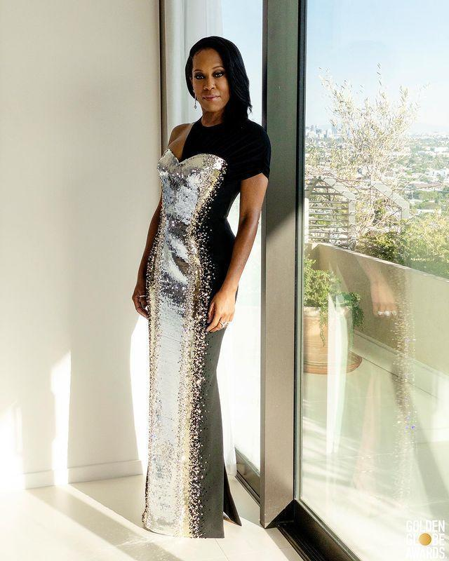 "<p><strong>What:</strong> Louis Vuitton</p><p><strong>Why: </strong>If Regina King in silver sequins and black cut outs is the future—we're looking forward to it. The director and actor is refined as ever in the fashion-forward gown with an '80s futurism vibe. </p><p><a href=""https://www.instagram.com/p/CL26ri_FWYe/?utm_source=ig_embed&utm_campaign=loading"" rel=""nofollow noopener"" target=""_blank"" data-ylk=""slk:See the original post on Instagram"" class=""link rapid-noclick-resp"">See the original post on Instagram</a></p>"