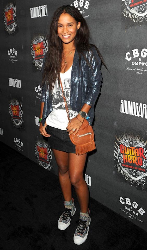 "Actress Joy Bryant sported funky sneakers, a tiny fringed handbag, and a flashy sequined jacket. Do you like her rock 'n' roll style? Jason Merritt/<a href=""http://www.gettyimages.com/"" target=""new"">GettyImages.com</a> - September 27, 2010"