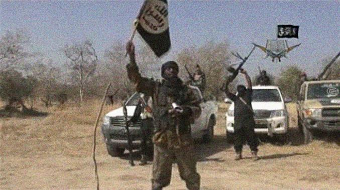 A screen grab made on January 20, 2015 from a video of Nigerian Islamist extremist group Boko Haram obtained by AFP shows the group's leader, Abubakar Shekau, holding a flag as he delivers a message (AFP Photo/)